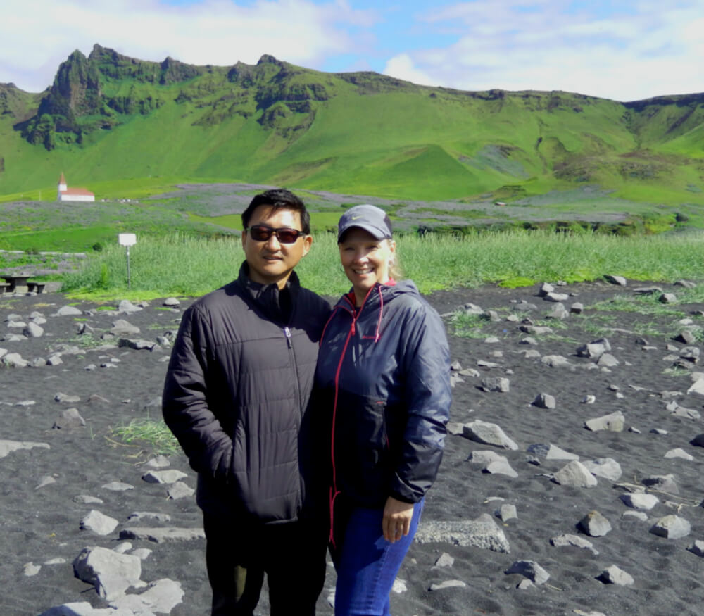 A photo of Wendy and Jason on the black sand beach in Vik Iceland