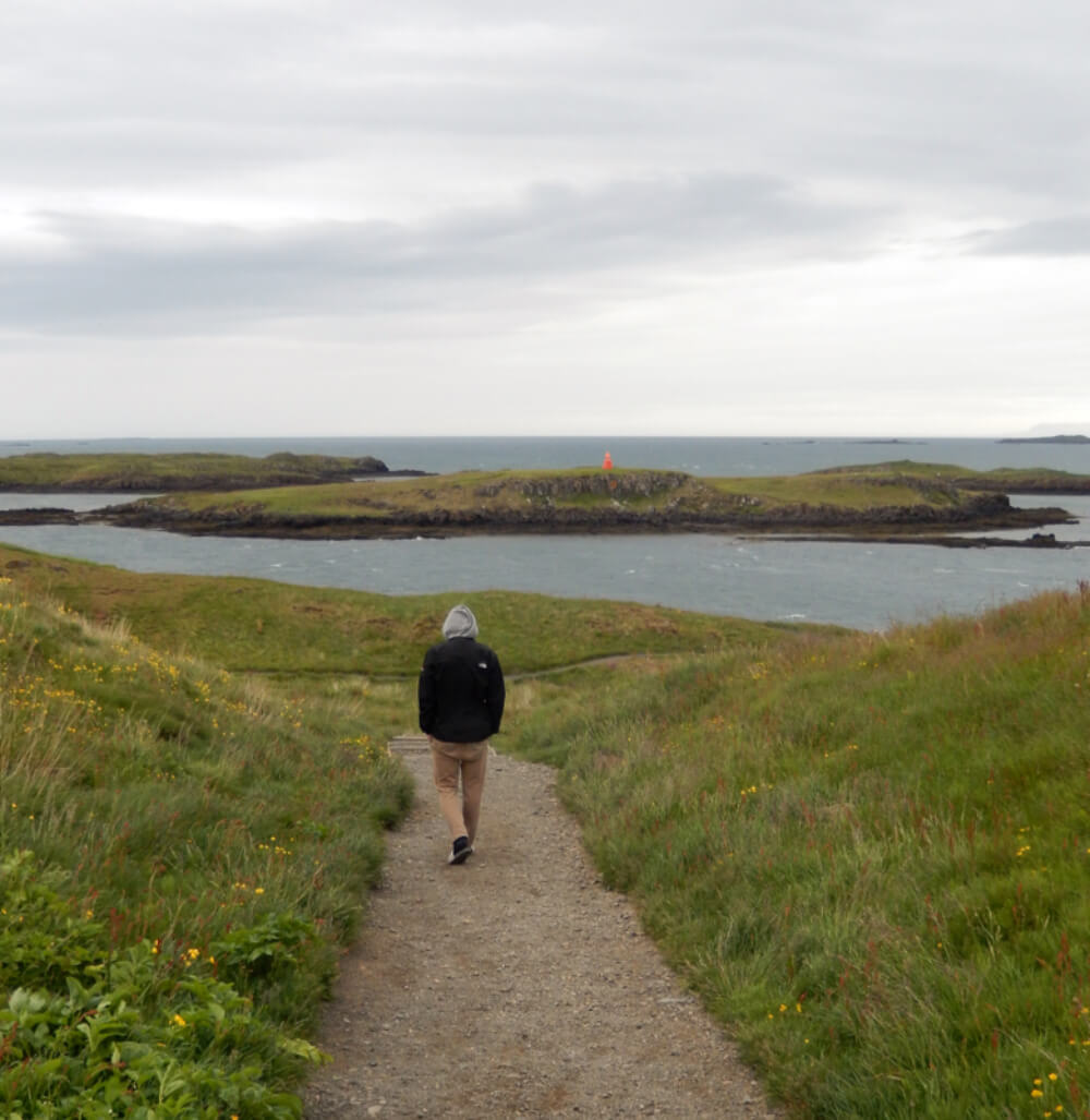 A photo of our son, Ryan, walking along a path on Súgandisey Island