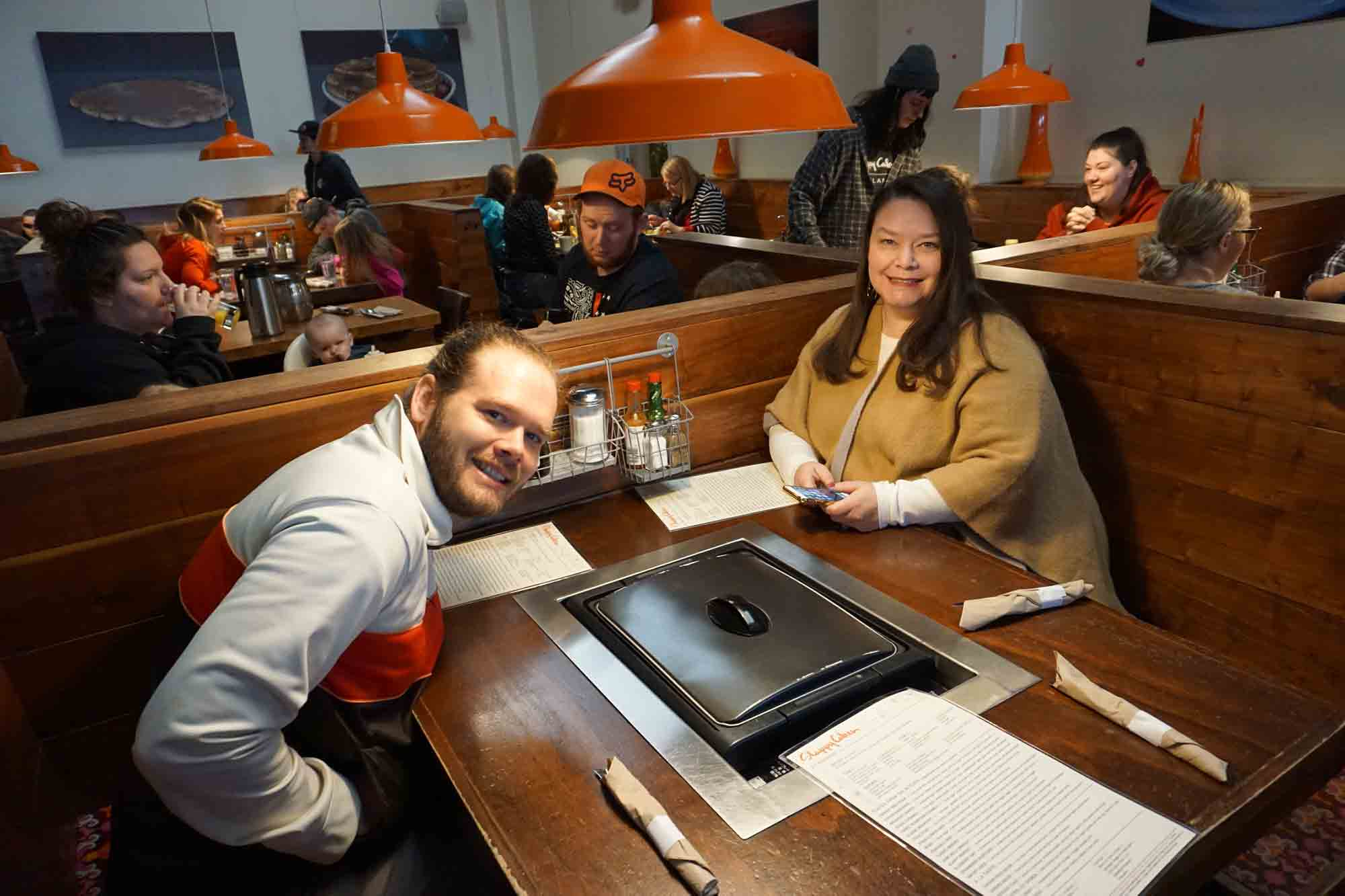 Erik and Beth sitting at a table at the restaurant Slappy Cakes in Portland Oregon