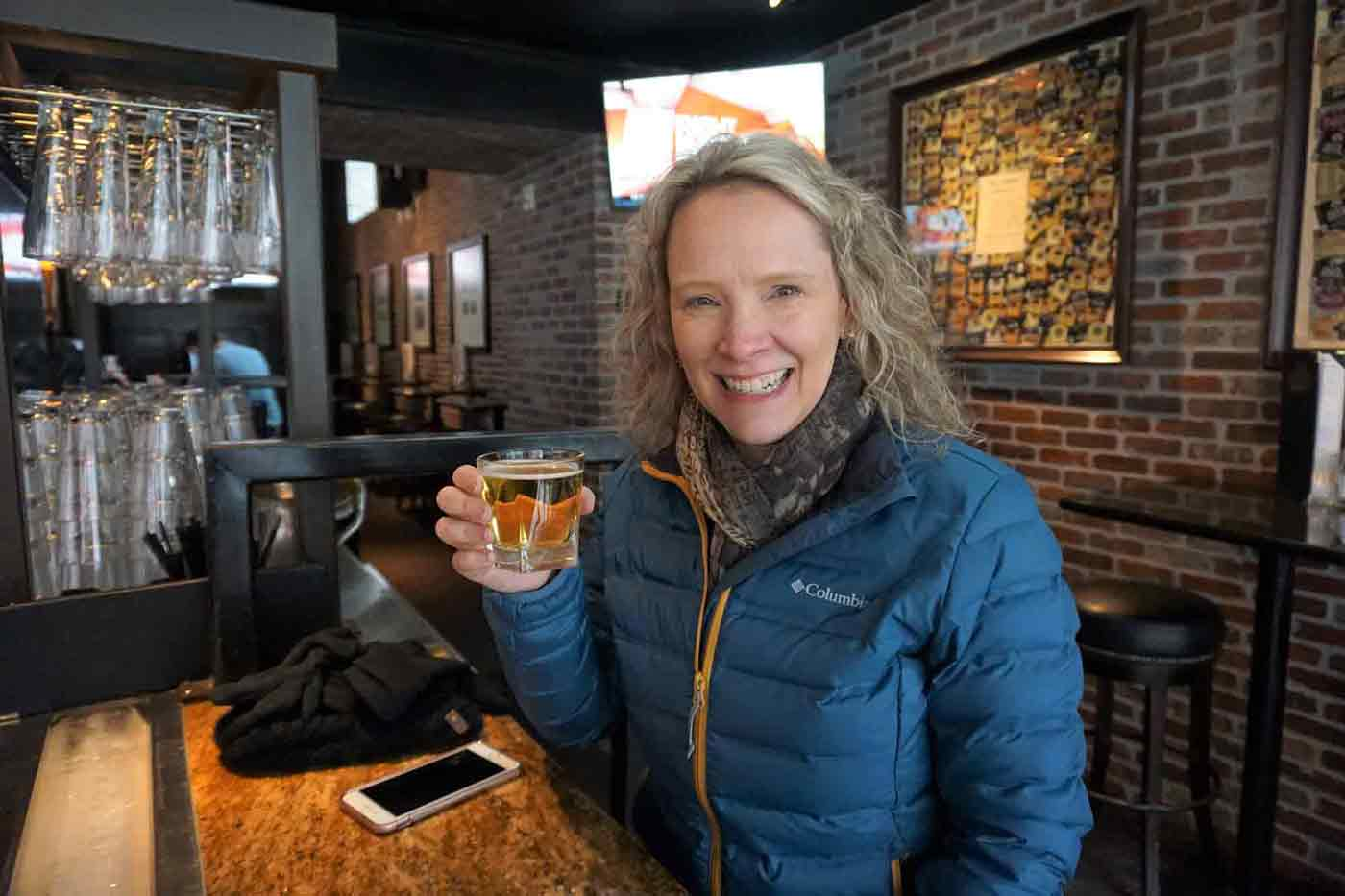 Wendy during the self-guided beer tour sampling a small beer at Henry's 12th Street Tavern in Portland Oregon