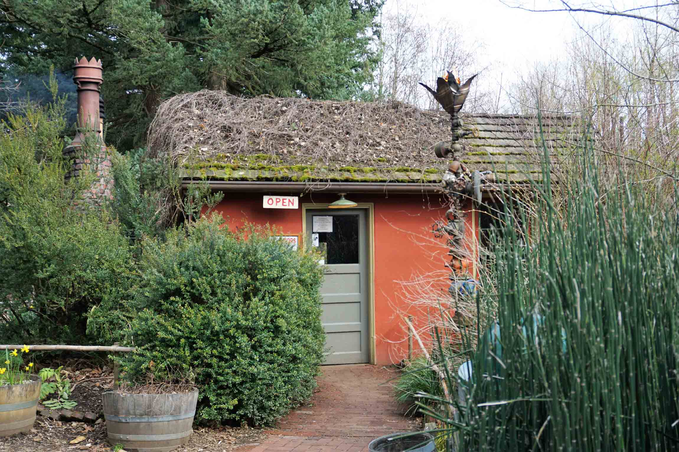 A photo of the Little Red Shed, a small building that serves as a bar on the property of McMenamin's Edgefield in Troutdale Oregon