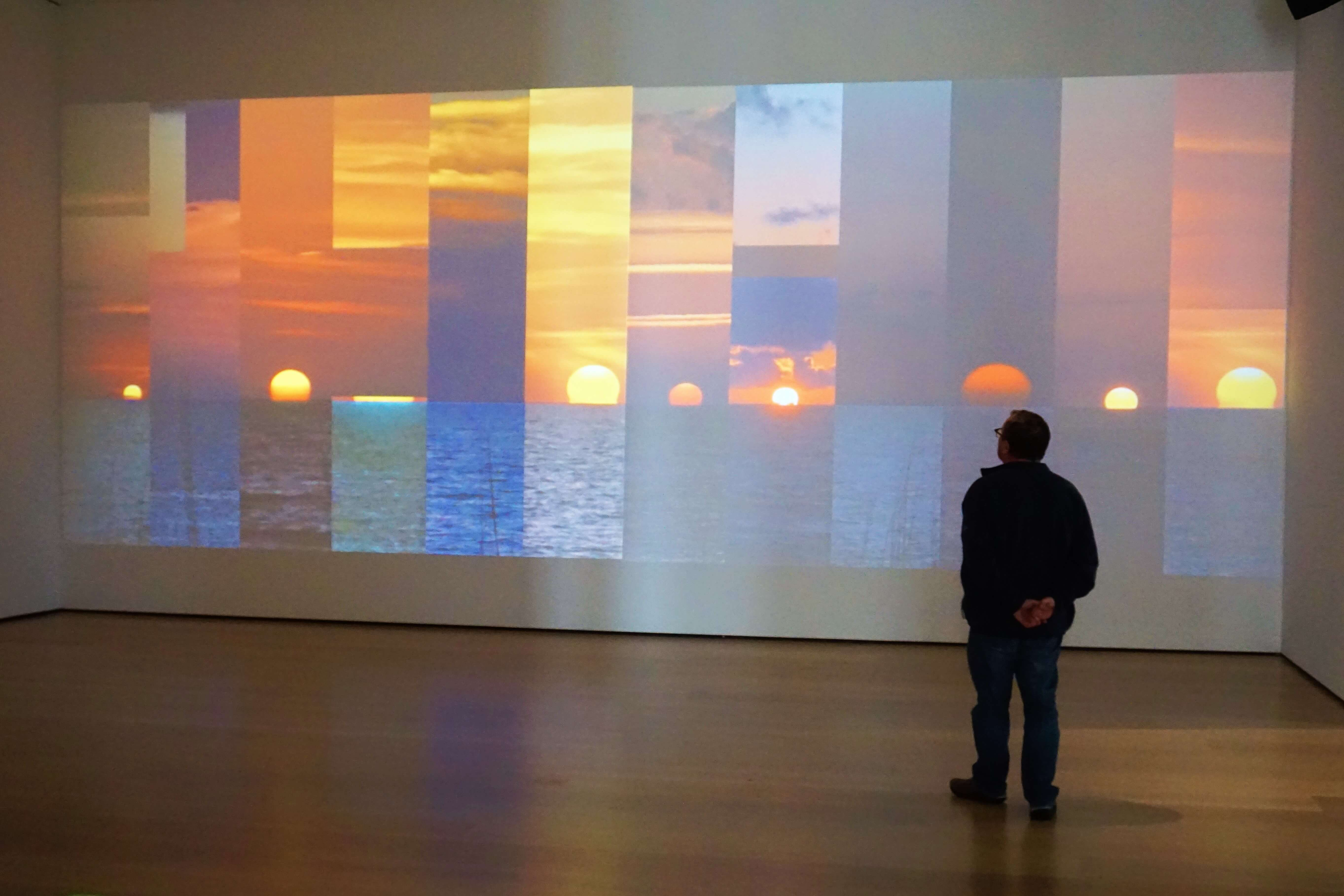 From the Hammer Museum exhibit, Unspeakable; Atlas, Kruger, Walker. A series of sunset photos is projected on the wall