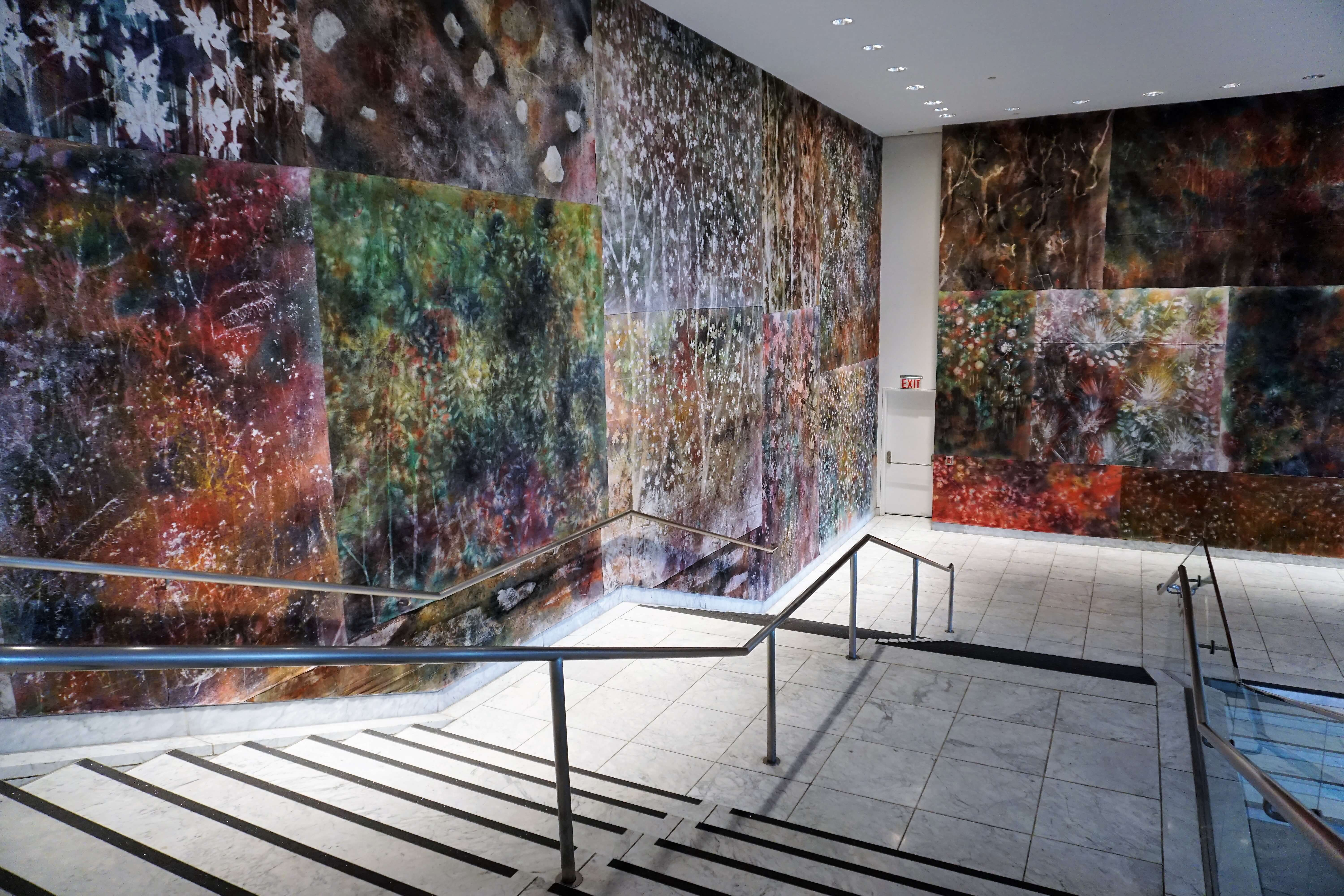Hammer Museum lobby decorated with colorful nature influenced art by Sam Falls