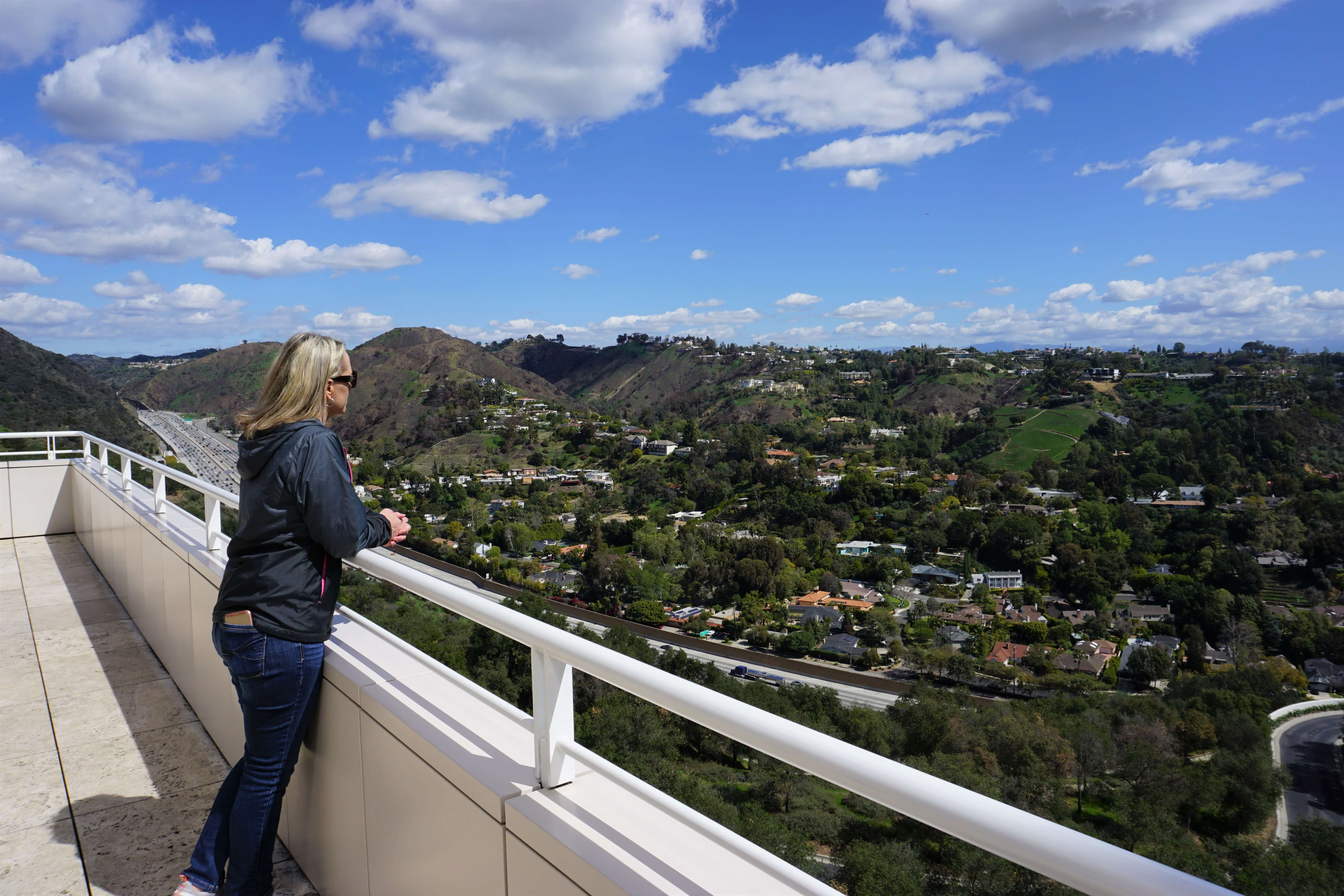 Wendy enjoying the view of the surrounding homes and hills as seen from the Getty Museum