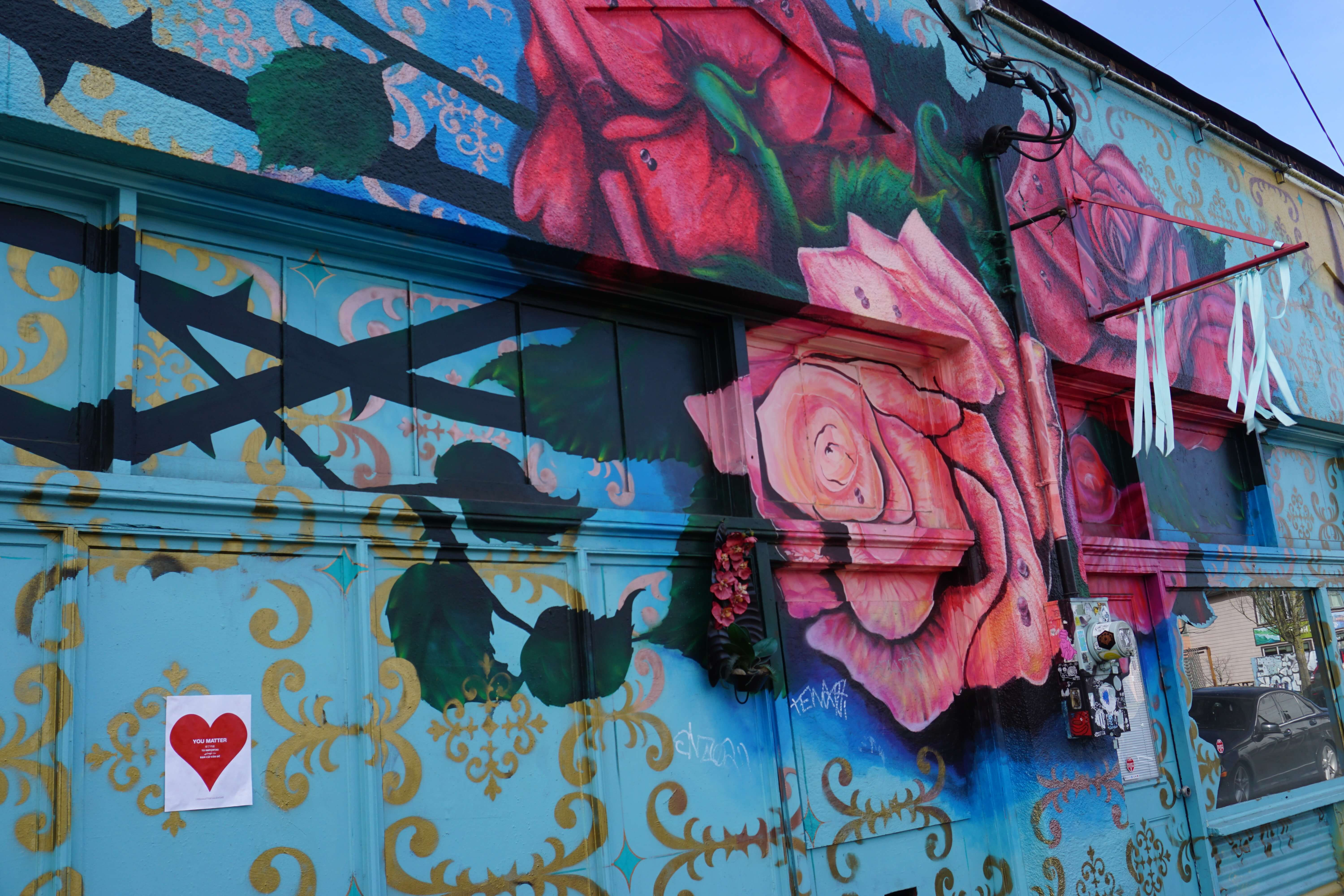 A lovely mural of roses in the Alberta Arts District