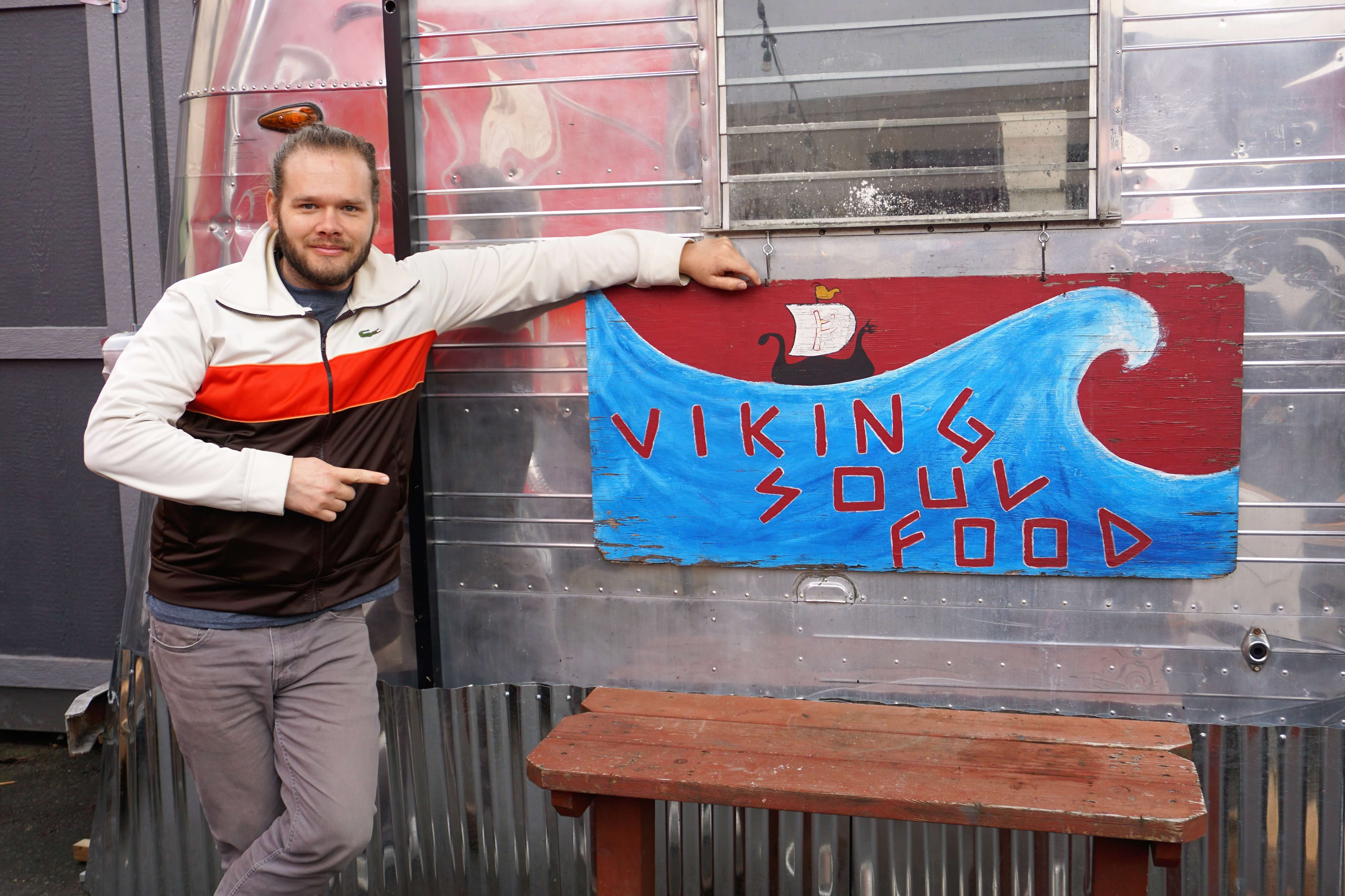Erik posing in front of an unusual food truck, Viking Soul Food