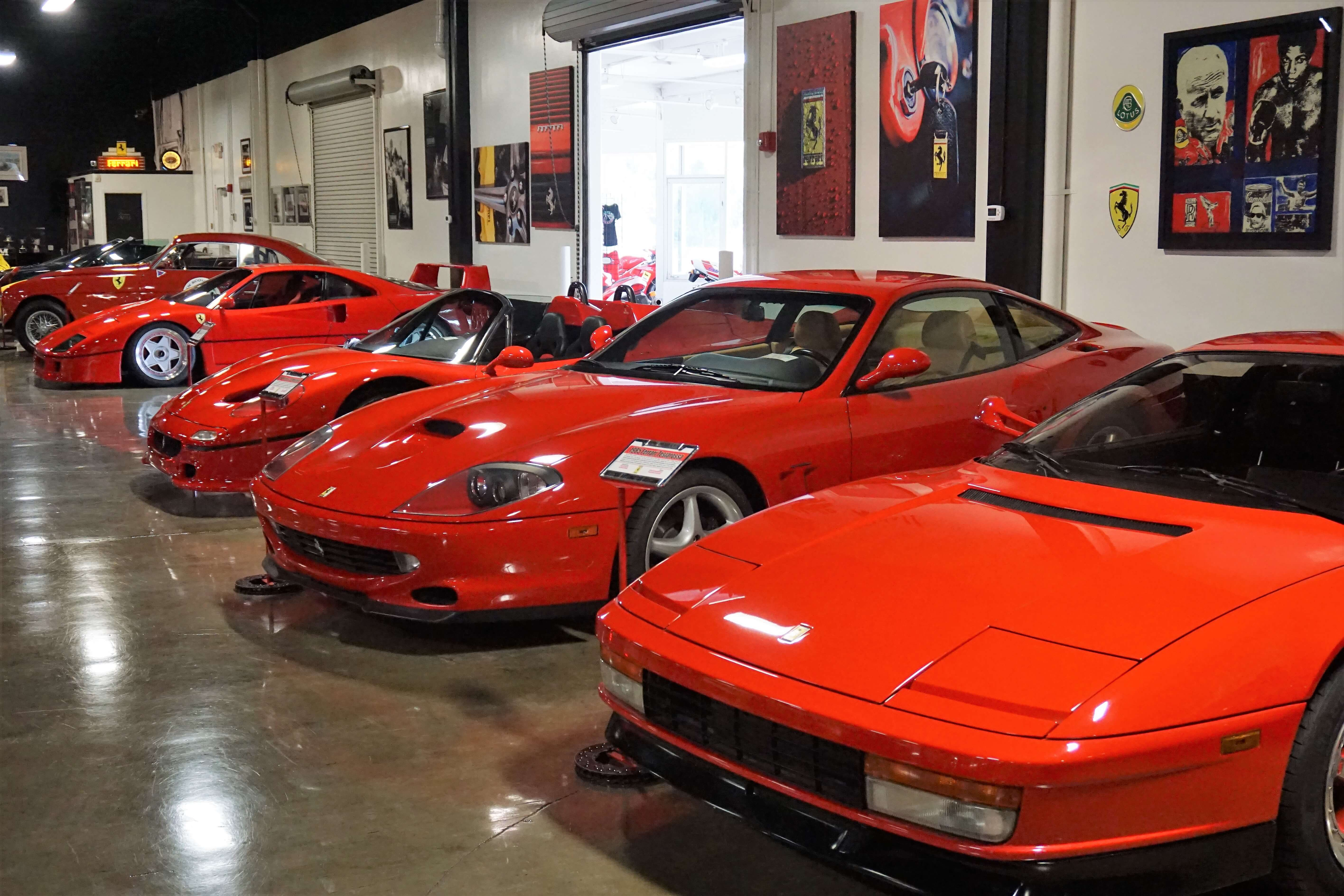 A row of red cars inside the Marconi Automotive Museum