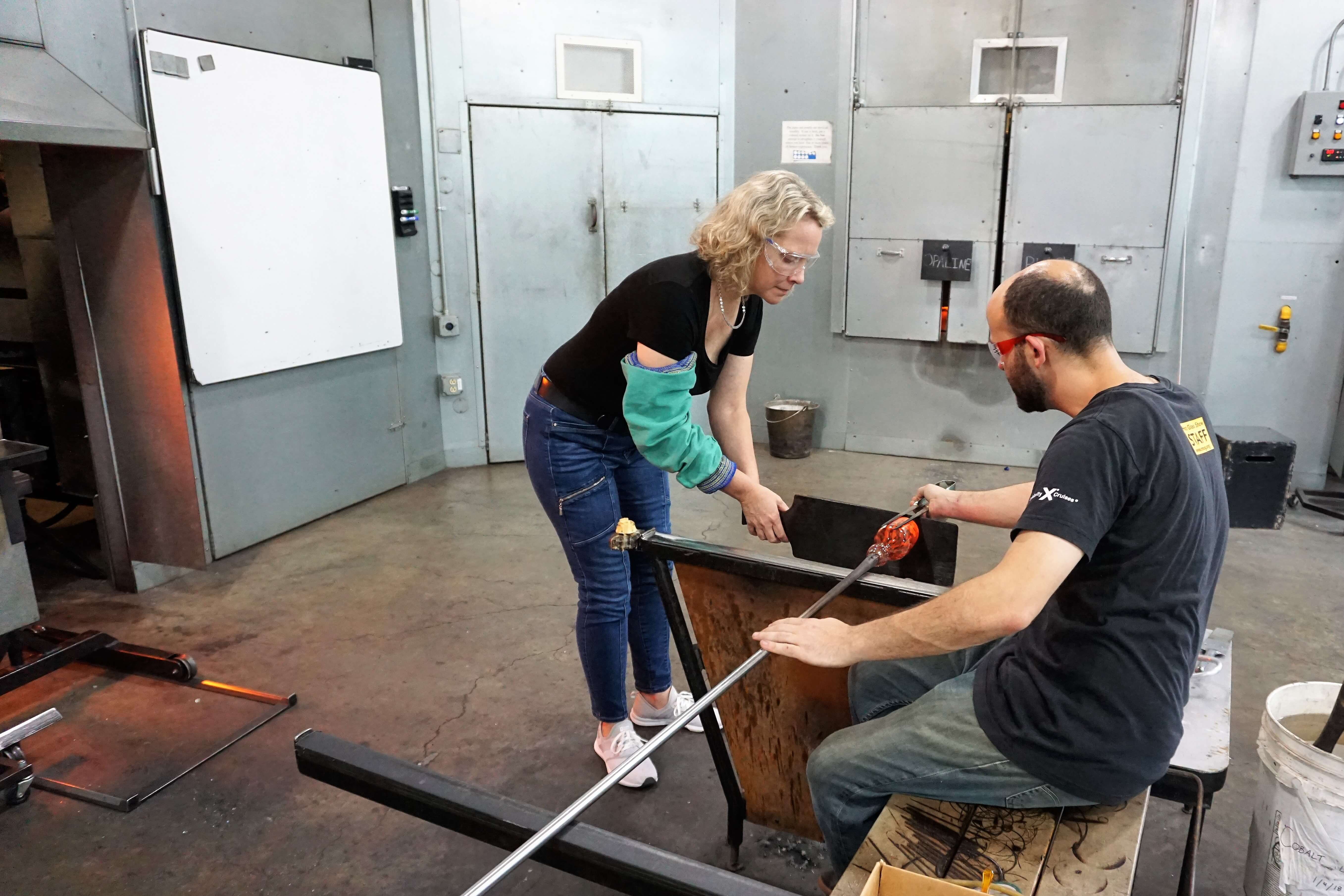 Wendy at a glass blowing class at Corning Museum of Glass