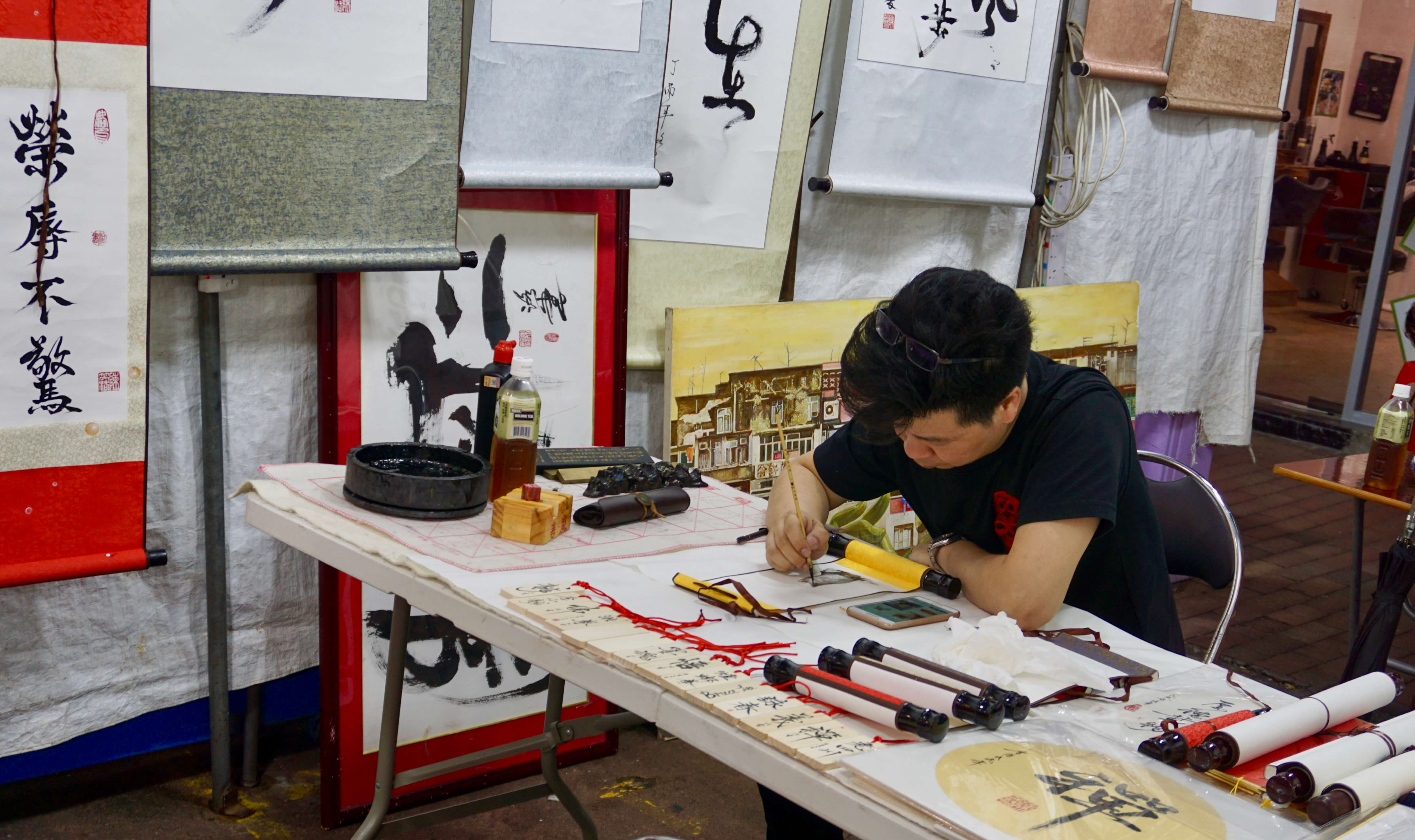 A calligrapher at the Temple Street Market in Hong Kong