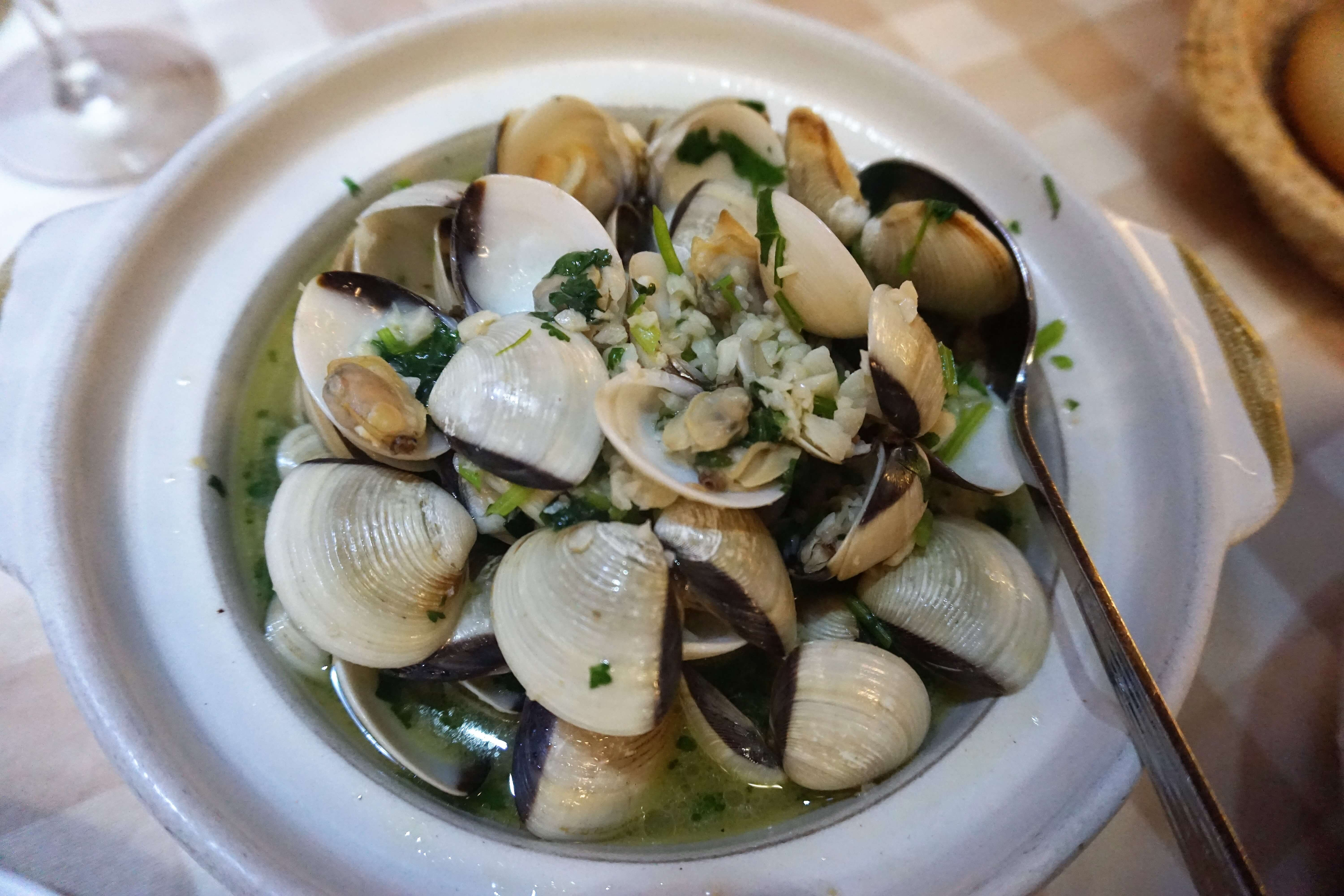 Traditional Portuguese dish of clams in white wine sauce
