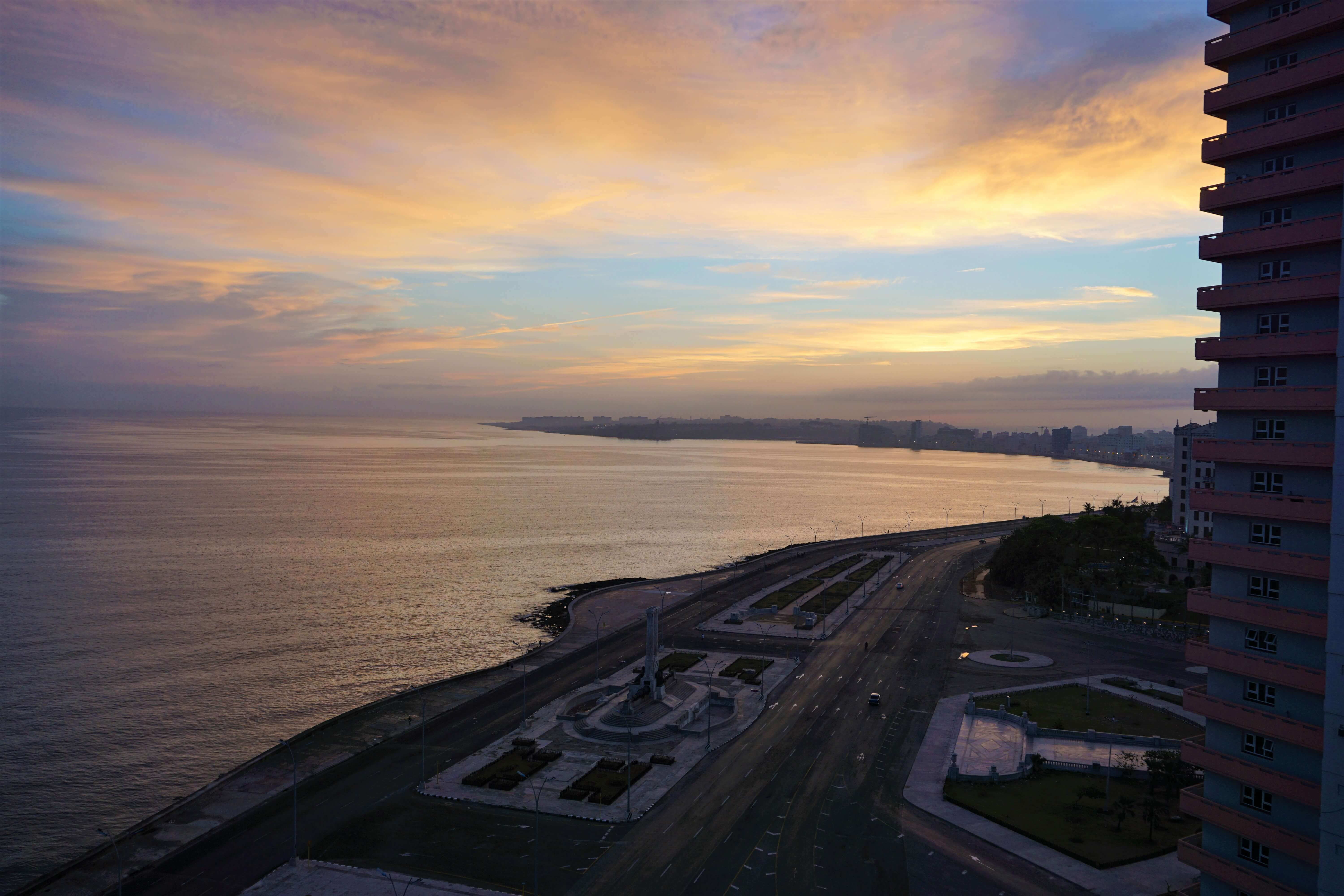 Sunrise over the Havana Harbor and view of the Malecon