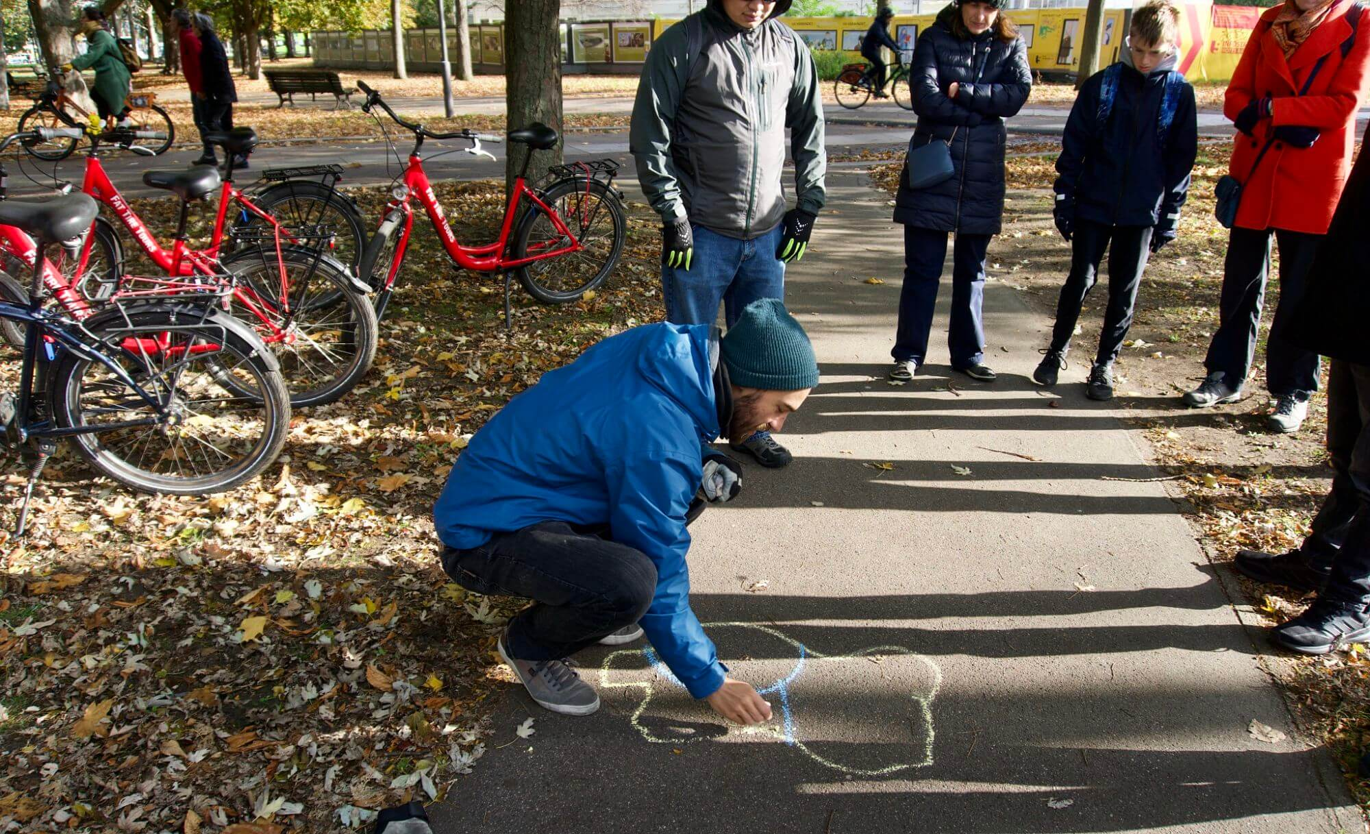 Bike tour guide, Jeff, drawing a map of Germany on the pavement