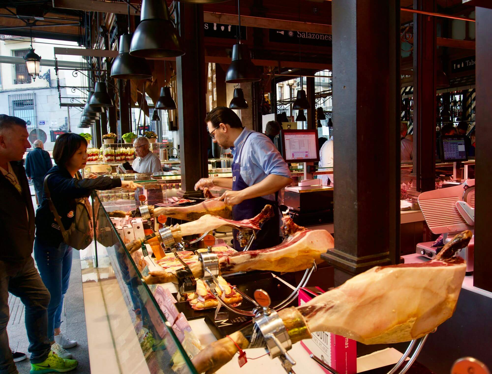 Jamon vendor in the Mercado de San Miguel in Madrid Spain