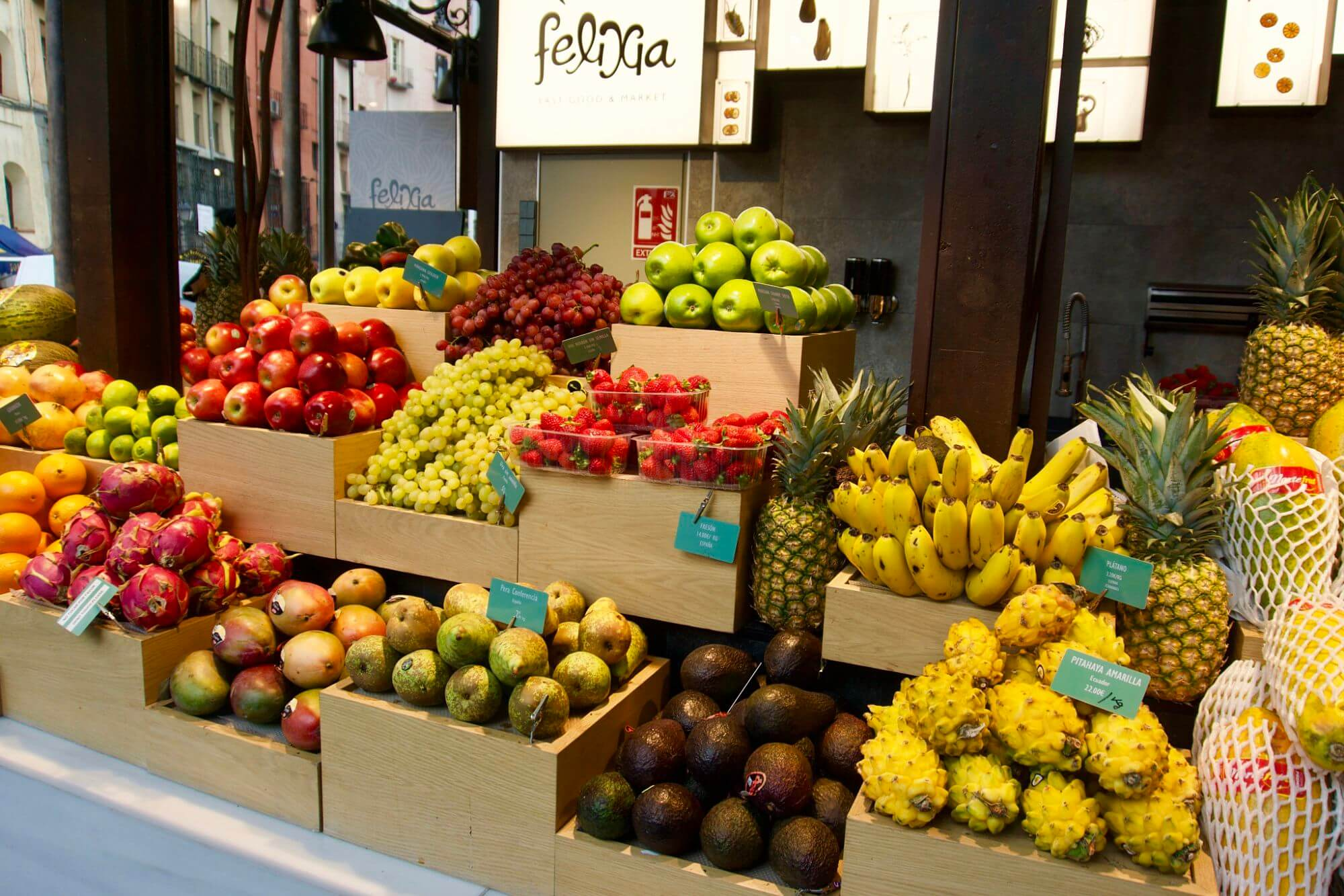 Fruit vendor in Mercado de San Miguel in Madrid Spain