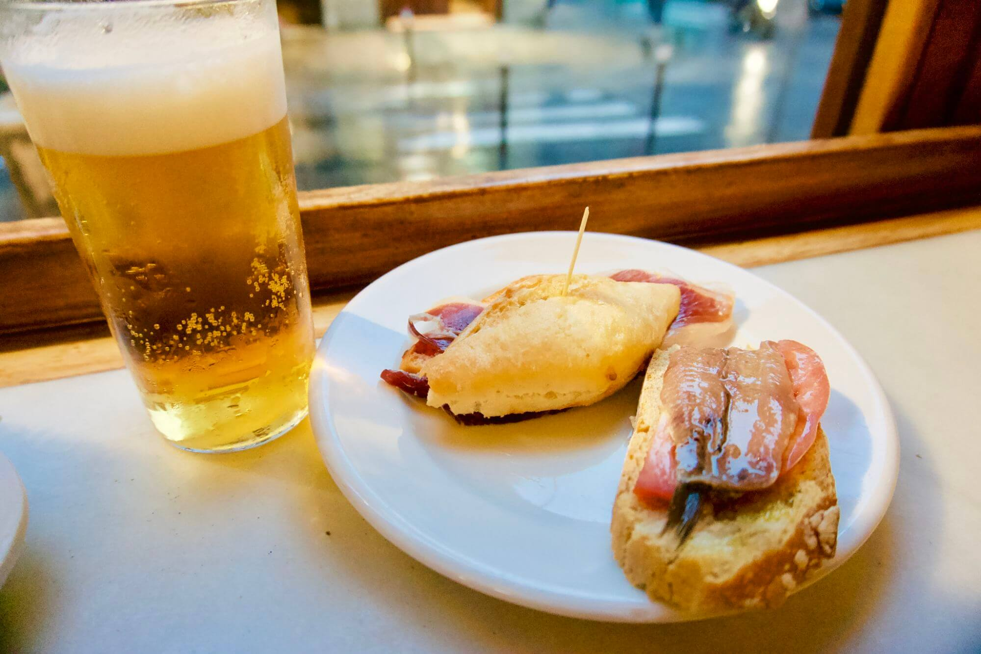 Tapas and beer at a neighborhood bar
