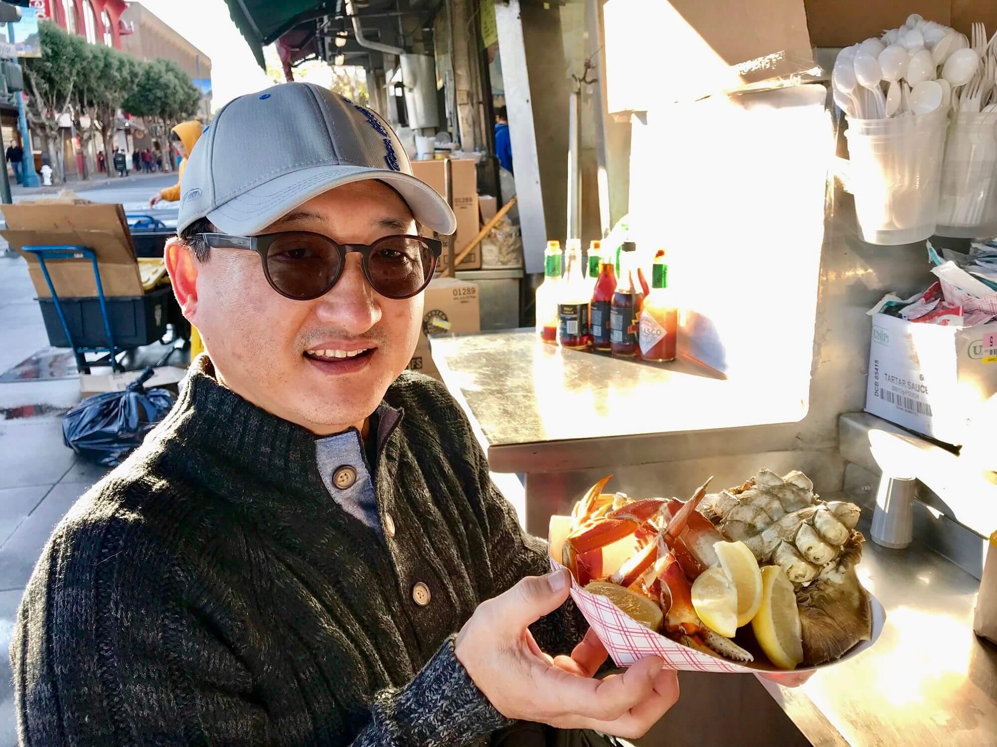 Jason eating crab at Fisherman's Wharf in San Francisco