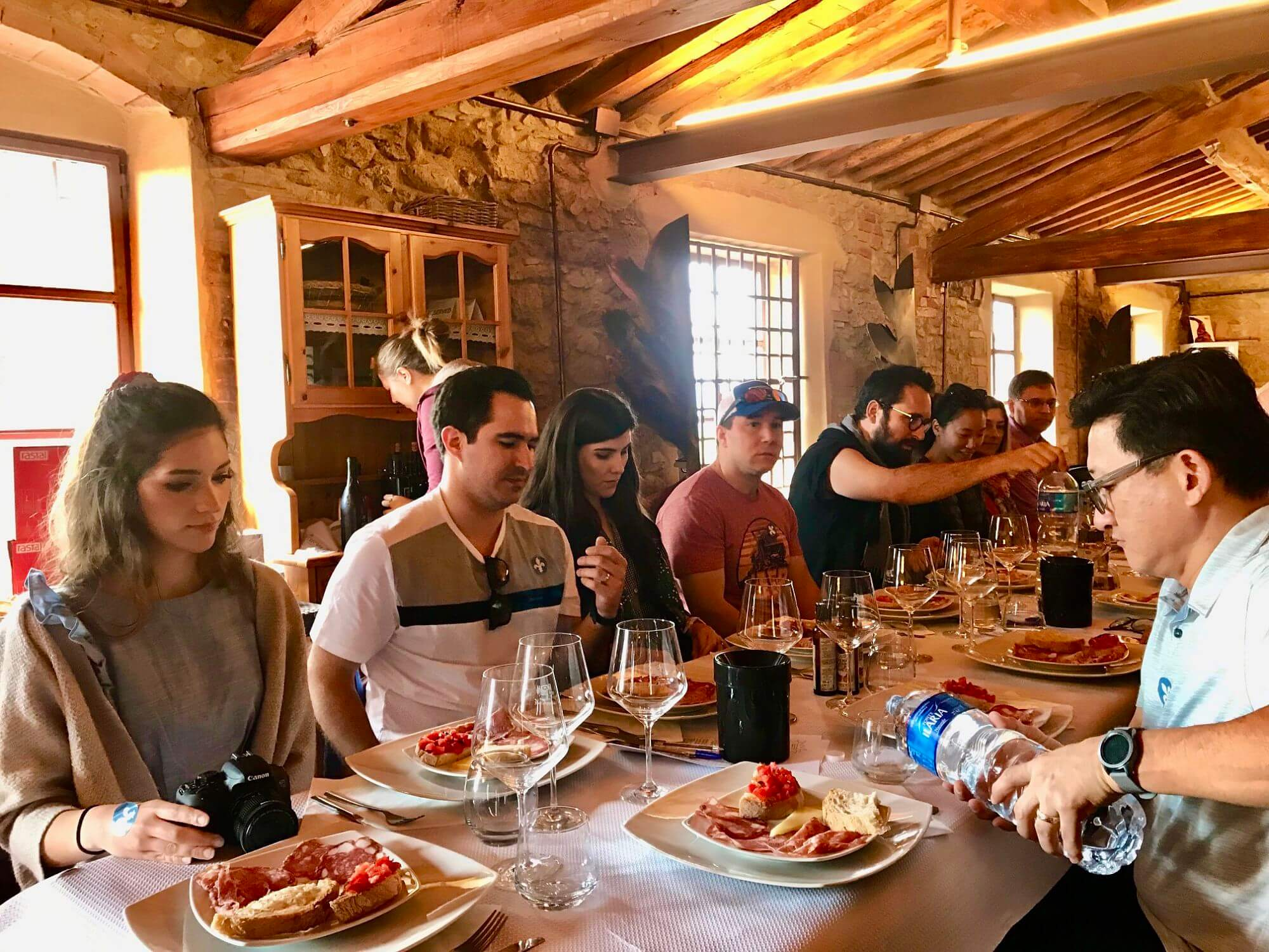Tour group enjoying lunch at a winery in Chianti